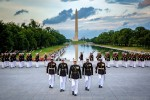 Marines with Marine Barracks Washington march in formation during the Sunset Parade at the Lincoln Memorial